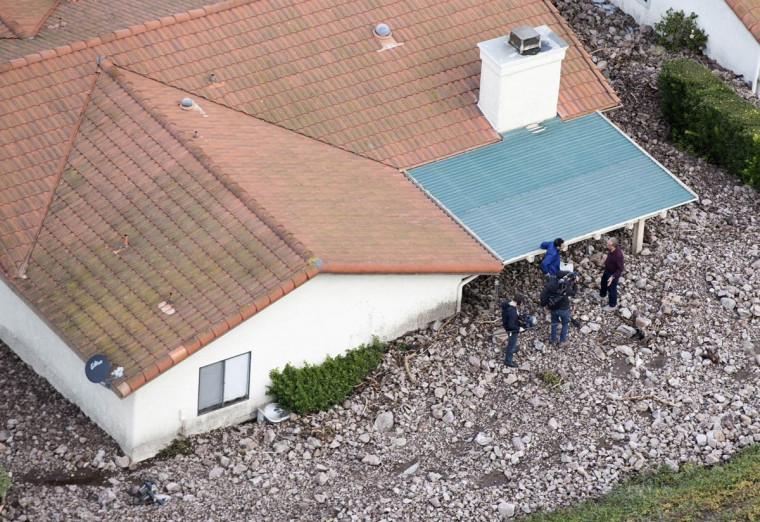A house is seen after boulder-strewn rivers of mud swept down hillsides during a winter storm, in Camarillo Springs, California December 12, 2014. (Mario Anzuoni/Reuters photo)