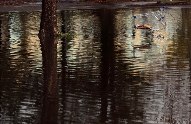 A shopping cart sits in a flooded parking lot in Santa Rosa, California December 12, 2014. A major storm pummeled California and the Pacific Northwest with heavy rain and high winds on Thursday, killing one man, knocking out power to tens of thousands of homes, disrupting flights and prompting schools to close. (Robert Galbraith/Reuters photo)