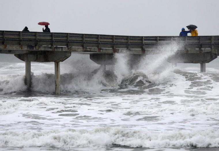 High waves crash under the Ocean Beach Pier as a winter storm brings rain and high winds to San Diego, California December 12, 2014. (Mike Blake/Reuters photo)