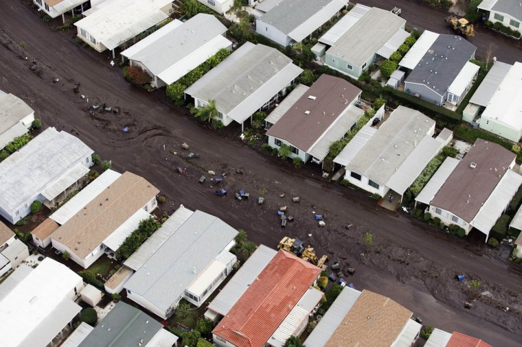 Garbage bins form a line between houses after boulder-strewn rivers of mud swept down hillsides during a winter storm, in Camarillo Springs, California December 12, 2014. (Mario Anzuoni/Reuters photo)
