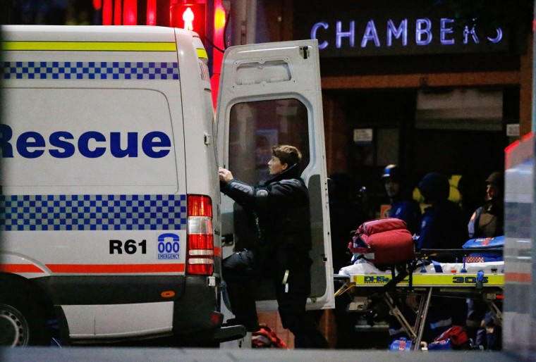 A police officer climbs into a rescue police patrol next to the Lindt Cafe, Martin Place during a hostage standoff on December 16, 2014 in Sydney, Australia. Police stormed the Sydney cafe after a gunman had taken hostages, ending the standoff. (Photo by Daniel Munoz/Getty Images)