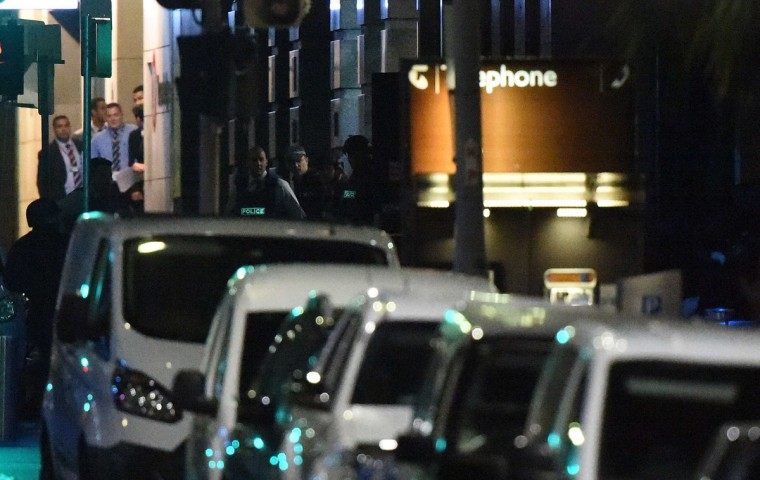 Armed Australian police carry out an operation outside the cafe following an operation in the central business district of Sydney on December 16, 2014. Police stormed the Sydney cafe where a gunman had taken hostages and displayed an Islamic flag, television footage showed early December 16. Police have confirmed the siege is over. (SAEED KHAN/AFP/Getty Images)