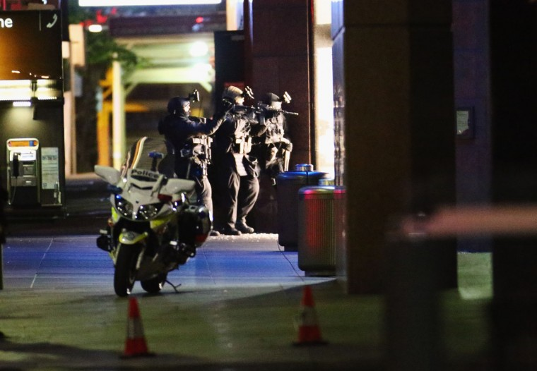 Armed police take aim outside the Lindt Cafe, Martin Place on December 15, 2014 in Sydney, Australia. Police attend a hostage situation at Lindt Cafe in Martin Place. (Photo by Don Arnold/Getty Images)