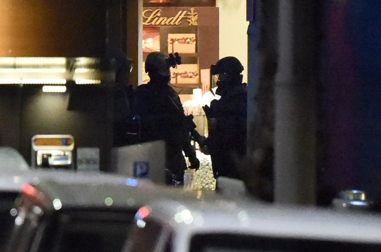 Police enter a cafe after a hostage siege in the central business district of Sydney on December 16, 2014. Police stormed the Sydney cafe where a gunman had taken hostages and displayed an Islamic flag, television footage showed early December 16. (WILLIAM WEST/AFP/Getty Images)