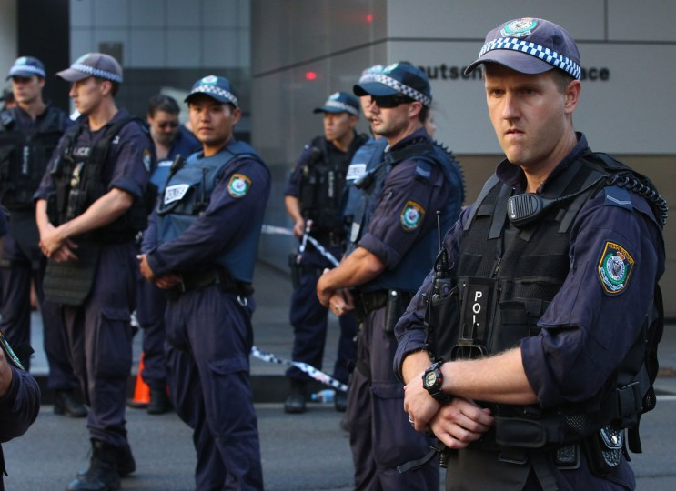 Police patrol the exclusion zone around Philip Street on December 15, 2014 in Sydney, Australia. (Photo by Don Arnold/Getty Images)