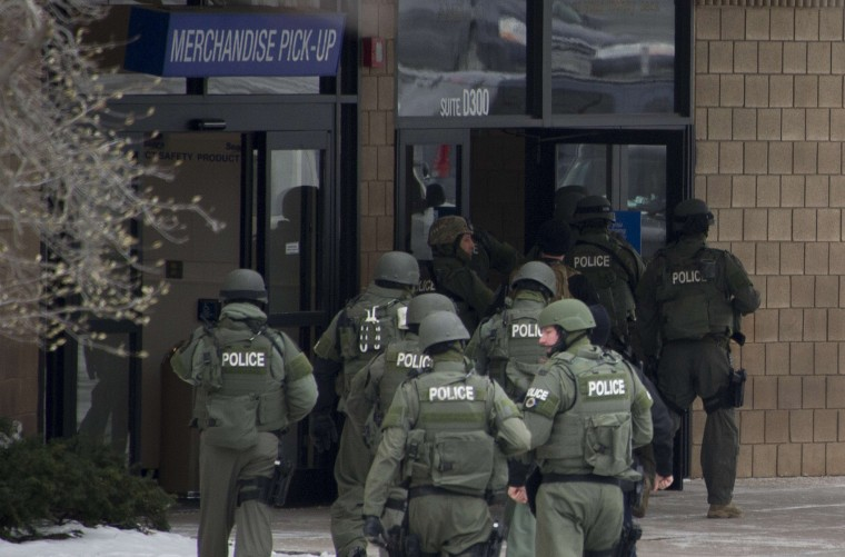 """Police enter the Sears department store at the Columbia Mall after a fatal shooting on January 25, 2014, in Columbia, Maryland. Three people were killed in a shooting at the popular shopping mall, located about 45 minutes outside Washington, authorities said Saturday. Howard County, Maryland, Police announced the fatalities and urged people inside the Mall """"to stay in place.""""Police said one of the dead was """"located near gun and ammunition."""" AFP PHOTO / Jim WATSONJIM WATSON/AFP/Getty Images"""