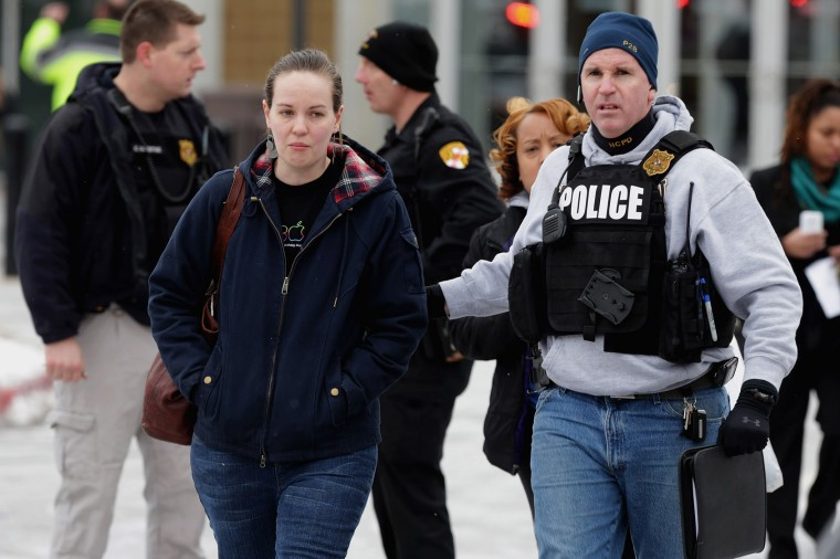 Police evacuate employees and patrons from the Columbia Town Center Mall after three people were killed in a shooting there January 25, 2014 in Columbia, Maryland. Police still do not have a motive for the shooting but believe the shooter has been killed. (Photo by Chip Somodevilla/Getty Images)