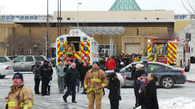 Emergency personnel escort people out from The Mall in Columbia, January 25, 2014. Three people died in a shooting at a large shopping center outside of Baltimore, Maryland, on Saturday, and police said they were allowing shoppers to leave the mall after determining there was no longer a threat. (REUTERS/DCMediagroup/Robert Brune)