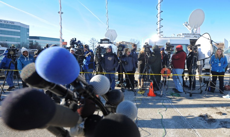 Members of the press wait for a press conference to begin at The Mall in Columbia by Howard County Police Chief Bill McMahon and Howard County Executive Ken Ulman the day after the shooting, Sunday, Jan. 26, 2014. (Photo by Algerina Perna/Baltimore Sun)