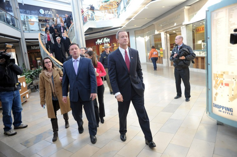Governor Martin O'Malley, right, is accompanied by County Executive Ken Ulman, and other dignitaries as they make their way to the food court at the Mall in Columbia for a press conference on Monday, Jan 27. (Brian Krista/BSMG)