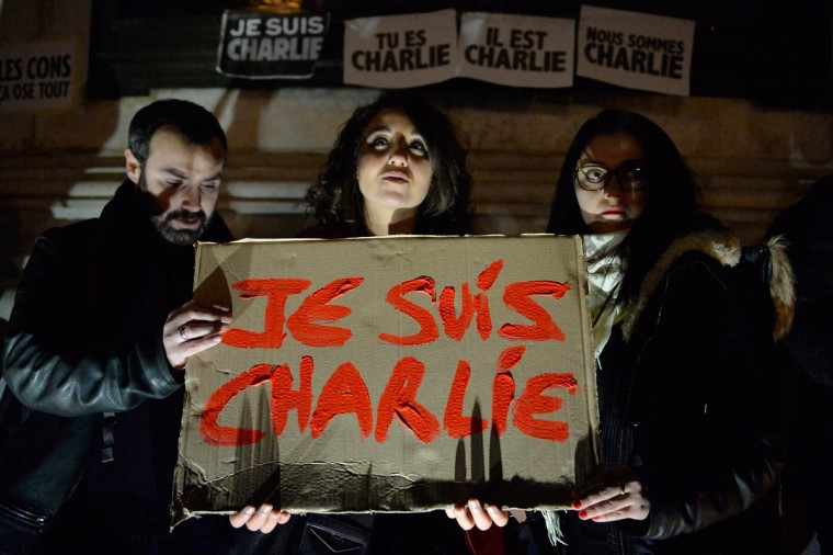 Supporters display placards during a gathering at the Place de la Republique (Republic square) in support of the victims after the terrorist attack earlier today on January 7, 2015 in Paris, France. Twelve people were killed, including two police officers, as two gunmen opened fire at the offices of the French satirical publication Charlie Hebdo. (Aurelien Meunier/Getty Images)