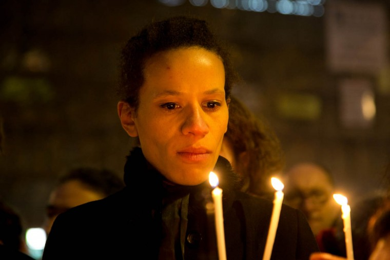 People hold a candles as crowds gather at 'Place de la Republique' for a vigil following the terrorist attack earlier today on January 7, 2015 in Paris, France. Twelve people were killed, including two police officers, as two gunmen opened fire at the offices of the French satirical publication Charlie Hebdo. (Marc Piasecki/Getty Images)