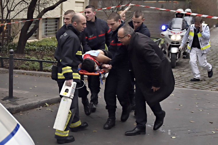 A victim is evacuated on a stretcher on January 7, 2015 after armed gunmen stormed the offices of the French satirical newspaper Charlie Hebdo in Paris, leaving at least 11 people dead. (Martin Bureau/Getty Images)