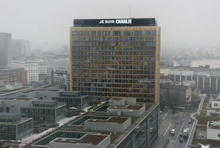 "The lettering ""Je suis Charlie"" (I am Charlie) is displayed on the roof of the German Axel Springer publishing group headquarters in Berlin on January 8, 2015 in commemoration of the victims of an attack by armed gunmen on the offices of French satirical newspaper Charlie Hebdo in Paris on January 7 which left at least 12 dead and many others injured. Stephanie Pilick/AFP/Getty Images"