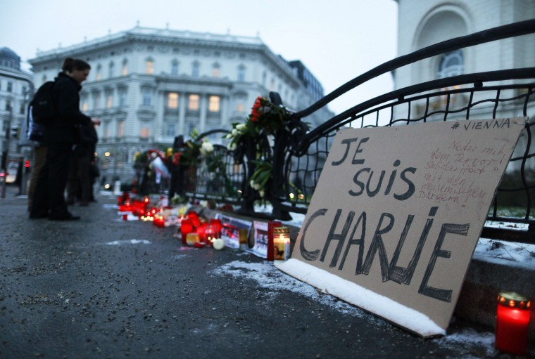 "Candles and a poster reading "" Je suis Charlie "" are seen in front of the French embassy in Vienna on January 8, 2015 a day after the Islamic attack on French satirical weekly Charlie Hebdo in Paris. Cities and towns across Europe staged vigils since January 7, 2015 in solidarity with the French people after an armed rampage against the paper left 12 dead. Patrick Domingo/AFP/Getty Images"