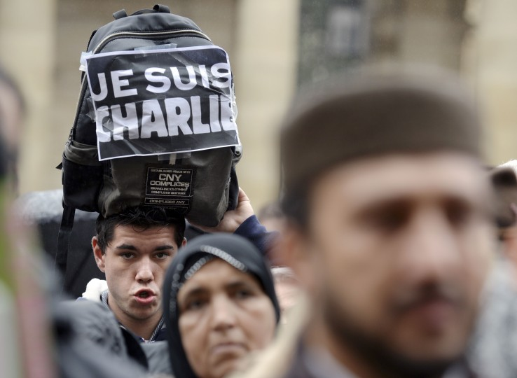 "A man holds a sign reading ""Je suis Charlie"" on January 9, 2015 during a walk in Bordeaux to show mutual solidarity following an attack by gunmen on the offices of the satirical weekly Charlie Hebdo on January 7 which left 12 dead. Jean Pierre Muller/AFP/Getty Images"