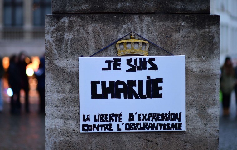 "A sign reading ""Je suis Charlie"" (I am Charlie) and ""Freedom of speech in the face of obscurantism"" hangs on a wall during a gathering in Brussels on January 9, 2015 to pay tribute to the victims of a deadly attack on the Paris headquarters of French weekly Charlie Hebdo. Elite commandos units killed the two suspects in the Charlie Hebdo massacre during a simultaneous assault on the building they were holed up in and on a Paris Jewish supermarket, freeing hostages at both sites. Emmanuel Dunand/AFP/Getty Images"