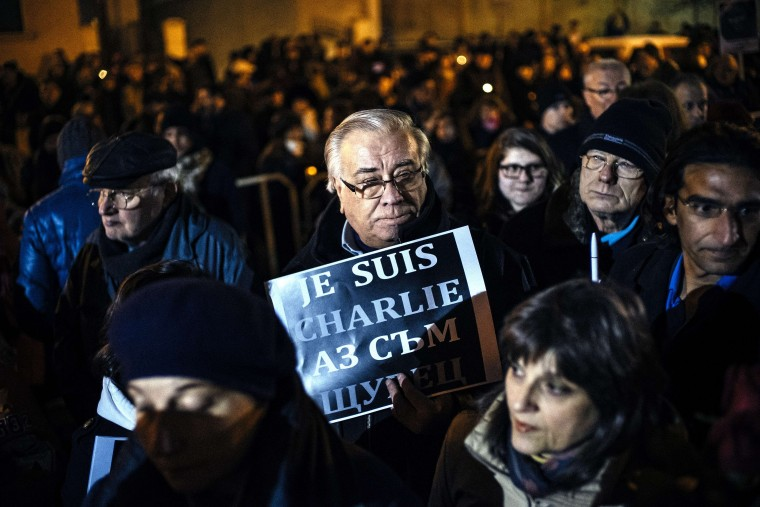 "A man holds a sign reading ""Je suis Charlie"" outside the French Embassy in Sofia on January 9, 2015, to pay homage to the victims of a deadly attack two days prior on the Paris headquarters of French satirical weekly Charlie Hebdo. Elite commandos on January 9 units killed the two suspects in the Charlie Hebdo massacre during a simultaneous assault on the building they were holed up in and on a Paris Jewish supermarket, freeing hostages at both sites. Dimitar Dilkoff/AFP/Getty Images"