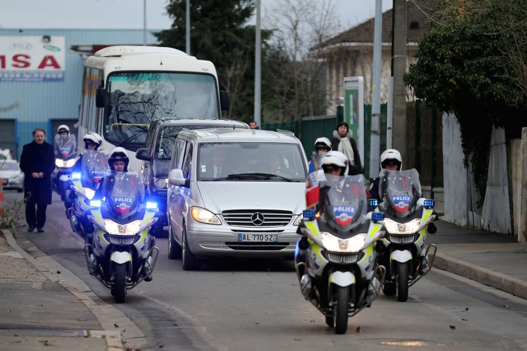The funeral cortege of murdered police officer Ahmed Merabet arrives at Bobigny Muslim cemetery on January 13, 2015 in Bobigny, France. The officers who were killed in last weeks' terrorist attacks were awarded a posthumous Legion dHonneur, in recognition of their bravery. The terrorist attacks began on Wednesday with the assault on the French satirical magazine Charlie Hebdo, killing 12, and ended on Friday with sieges at a printing company in Dammartin en Goele and a Kosher supermarket in Paris with four hostages and three suspects being killed. A fourth suspect, Hayat Boumeddiene, 26, escaped and is wanted in connection with the murder of a policewoman (Photo by Christopher Furlong/Getty Images)