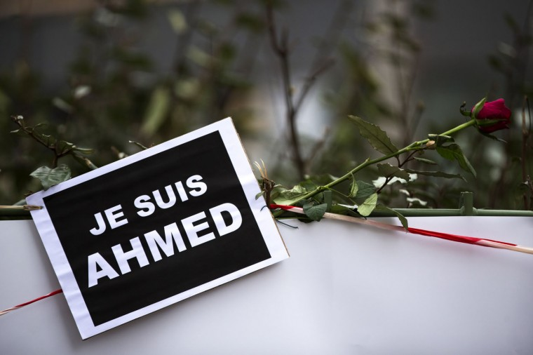 A tribute to murdered police officer Ahmed Merabet ahead of his funeral on January 13, 2015 in Bobigny, France. All three police officers killed in last weeks attacks have been awarded a posthumous Legion d'Honneur, in recognition of their bravery. The terrorist attacks began on Wednesday with the assault on the French satirical magazine Charlie Hebdo, killing 12, and ended on Friday with sieges at a printing company in Dammartin en Goele and a Kosher supermarket in Paris with four hostages and three suspects being killed. A fourth suspect, Hayat Boumeddiene, 26, escaped and is wanted in connection with murder of a policewoman. (Photo by Dan Kitwood/Getty Images)