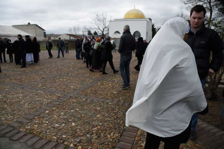 General atmosphere is seen prior to the funeral of murdered police officer Ahmed Merabet at a muslim cemetery on January 13, 2015 in Bobigny, France. All three police officers killed in last weeks attacks have been awarded a posthumous Legion d'Honneur, in recognition of their bravery. The terrorist attacks began on Wednesday with the assault on the French satirical magazine Charlie Hebdo, killing 12, and ended on Friday with sieges at a printing company in Dammartin en Goele and a Kosher supermarket in Paris with four hostages and three suspects being killed. A fourth suspect, Hayat Boumeddiene, 26, escaped and is wanted in connection with the murder of a policewoman. (Photo by Pascal Le Segretain/Getty Images)