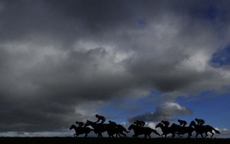 Runners in The Higos Insurance Services Somerton Handicap Hurdle Race make their way down the back straight at Wincanton racecourse on January 15, 2015 in Wincanton, England. (Photo by Alan Crowhurst/Getty Images)