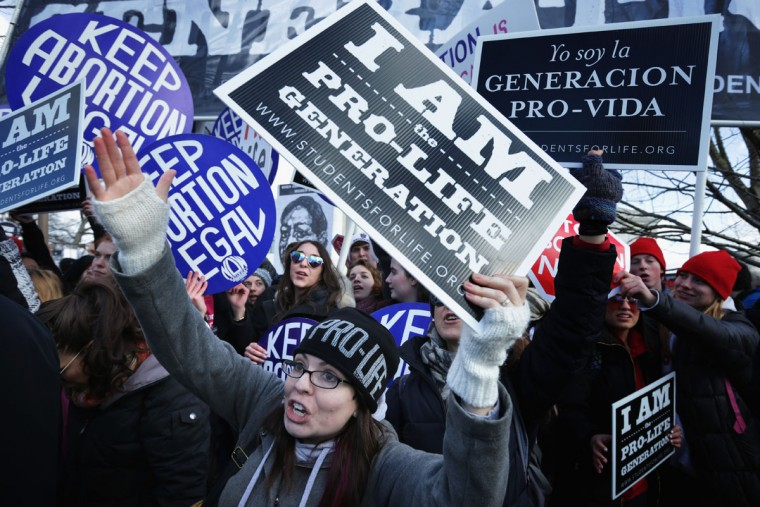 Pro-life activists try to block pro-choice activists as the annual March for Life passes by in front of the U.S. Supreme Court January 22, 2015 in Washington, DC. (Photo by Alex Wong/Getty Images)