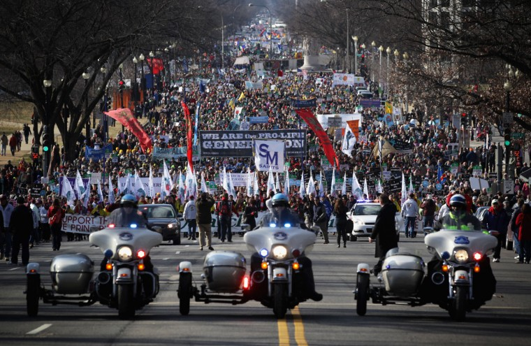 Pro-life activists participate in the annual March for Life as they march up Constitution Avenue January 22, 2015 in Washington, DC. (Photo by Alex Wong/Getty Images)