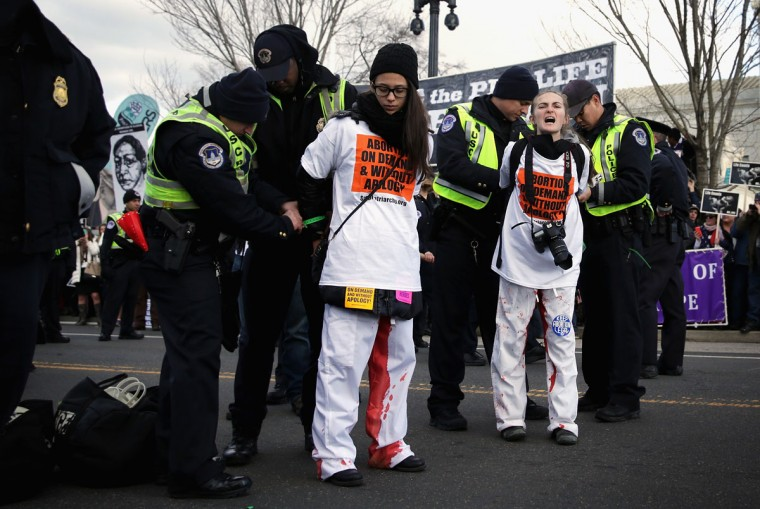 U.S. Capitol Police arrests pro-choice activists after they blocked the street and temporarily stopped the annual March for Life in front of the U.S. Supreme Court January 22, 2015 in Washington, DC. (Photo by Alex Wong/Getty Images)