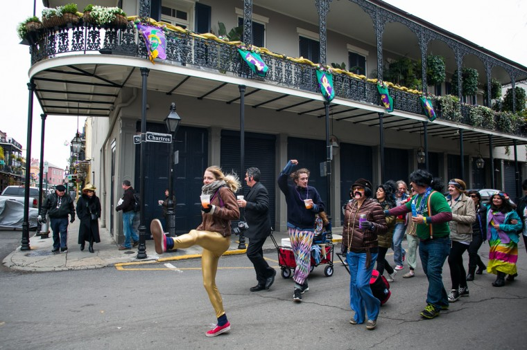 People sing songs while walking through the French Quarter during Mardi Gras February 17, 2015 in New Orleans, Louisiana. Mardi Gras, or Fat Tuesday, is a celebration traditionally held before the observance of Ash Wednesday and the beginning of the Christian Lenten season. (Photo by Drew Anthony Smith/Getty Images)