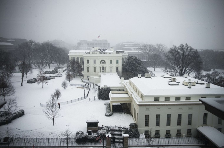 The White House and the West Wing are covered in snow after a small storm blew through Washington, DC, January 6, 2015. (Jim Watson/AFP/Getty Images)