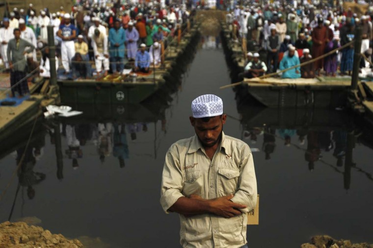 Muslim devotees offer noon prayers while attending the World Muslim Congregation, also known as Biswa Ijtema, at Tongi, on the outskirts of the Bangladesh capital Dhaka, on January 9, 2015. Muslims attending one of the world's largest religious gatherings joined the chorus of condemnation January 9 over the deadly attack on a French satirical weekly, saying the killings ran contrary to the tenets of Islam. Bangladesh's Biswa Ijtema, or World Muslim Congregation, is the world's second largest Islamic gathering after the Hajj with devotees coming from all over the globe to pray and hear imams preach for three days. (Hasan Raja/AFP/Getty Images)