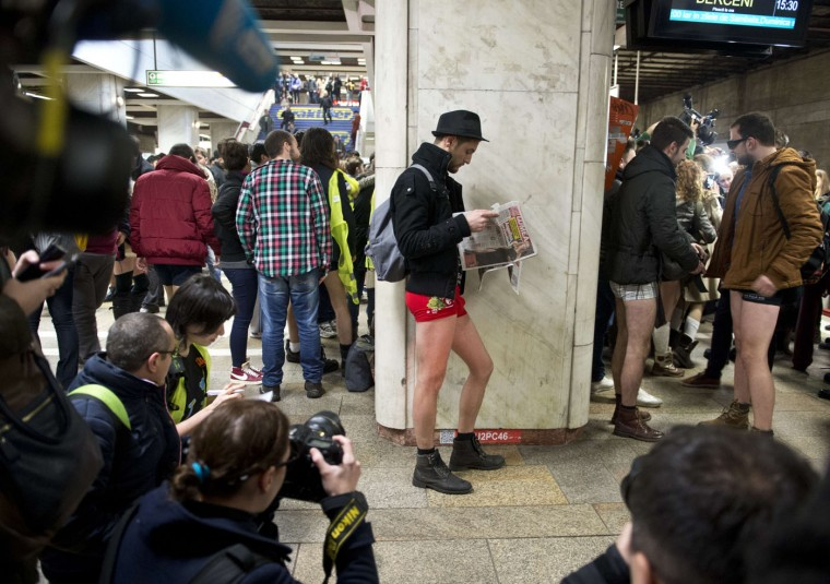 "Young men, stripped to their underpants, wait for the subway as they take part in Romania's first edition of the ""No pants subway ride day"" organized in Bucharest January 11, 2015. The No Pants Subway Ride is an annual event staged across major cities of the World every January. The mission started as a small prank with seven guys and has grown into an international celebration of silliness, with dozens of cities around the world participating each year. (Daniel Mihailescu/AFP/Getty Images)"
