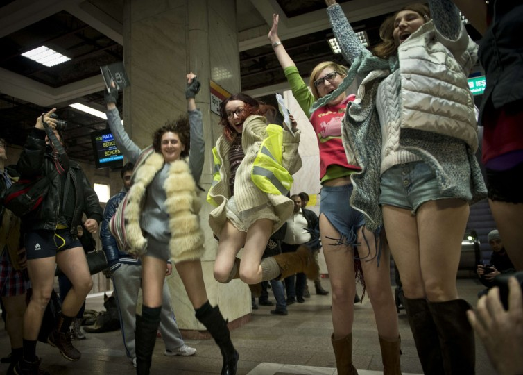 "Young people, stripped to their underpants, jump in the air while waiting for the subway as they take part in Romania's first edition of the ""No pants subway ride day"" organized in Bucharest January 11, 2015. The No Pants Subway Ride is an annual event staged across major cities of the World every January. The mission started as a small prank with seven guys and has grown into an international celebration of silliness, with dozens of cities around the world participating each year. (Daniel Mihailescu/AFP/Getty Images)"