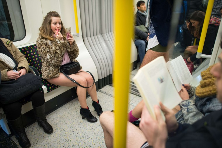 """People take part in the annual """"No Trousers On The Tube Day"""" event in central London on January 11, 2015. Originally started in the US, the international event, also known as the """"No Pants Subway Ride"""" was created by improvisation group """"Improv Everywhere"""" and sees people taking train journies while wearing no trousers, yet acting as normally as possible. (Leon Neal/AFP/Getty Images)"""