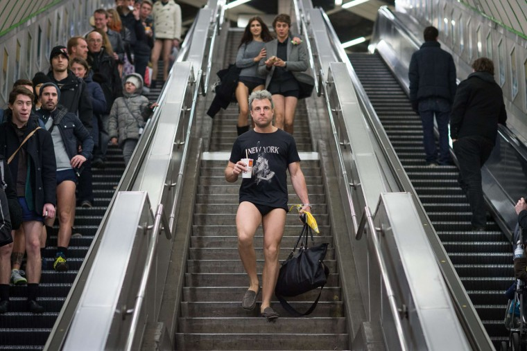 "People walk down stairs and take escalators as they take part in the annual ""No Trousers On The Tube Day"" event in central London on January 11, 2015. Originally started in the US, the international event, also known as the ""No Pants Subway Ride"" was created by improvisation group ""Improv Everywhere"" and sees people taking train journies while wearing no trousers, yet acting as normally as possible. (Leon Neal/AFP/Getty Images)"
