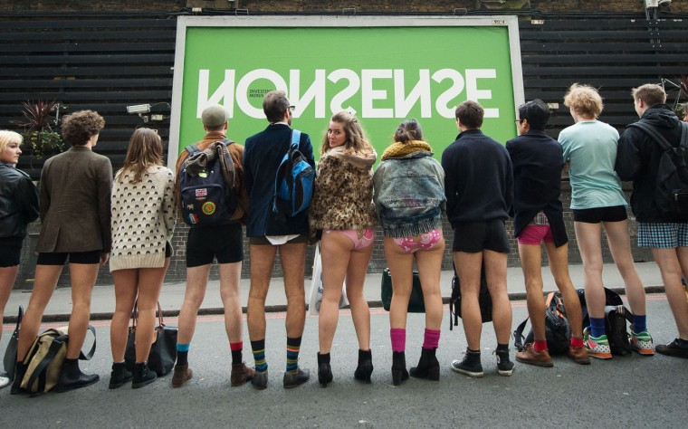 """People pose for a photograph before taking part in the annual """"No Trousers On The Tube Day"""" event in central London on January 11, 2015. Originally started in the US, the international event, also known as the """"No Pants Subway Ride"""" was created by improvisation group """"Improv Everywhere"""" and sees people taking train journies while wearing no trousers, yet acting as normally as possible. (Leon Neal/AFP/Getty Images)"""