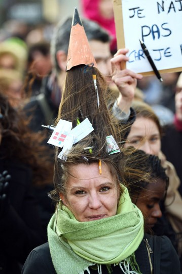 A woman with a pencil shape hairstyle takes part in a unity rally (Marche Republicaine) on January 11, 2015 on the old harbour in Marseille, southern France, in tribute to the 17 victims of the three-day killing spree. The killings began on January 7 with an assault on the Charlie Hebdo satirical magazine in Paris that saw two brothers massacre 12 people, including some of the country's best-known cartoonists, and the hostage-taking of a Jewish supermarket on the eastern fringes of the capital, which killed four people. )Anne-Christine Poujoulatanne/AFP/Getty Images)