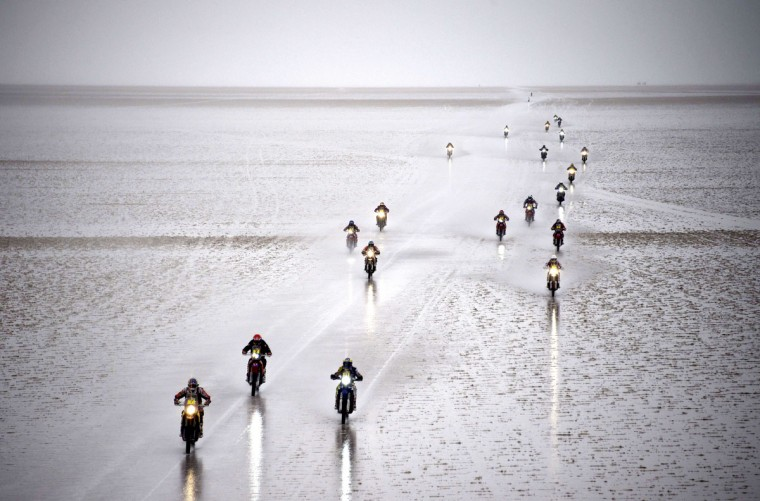 Riders compete during 2015 Dakar Rally stage 8 between Uyuni, Bolivia and Iquique, Chile, on January 12, 2015. The Uyuni salt flat is the largest in the world, located in Bolivia near the crest of the Andes, some 3,650 meters above sea level. (Frank Fife/AFP/Getty Images)