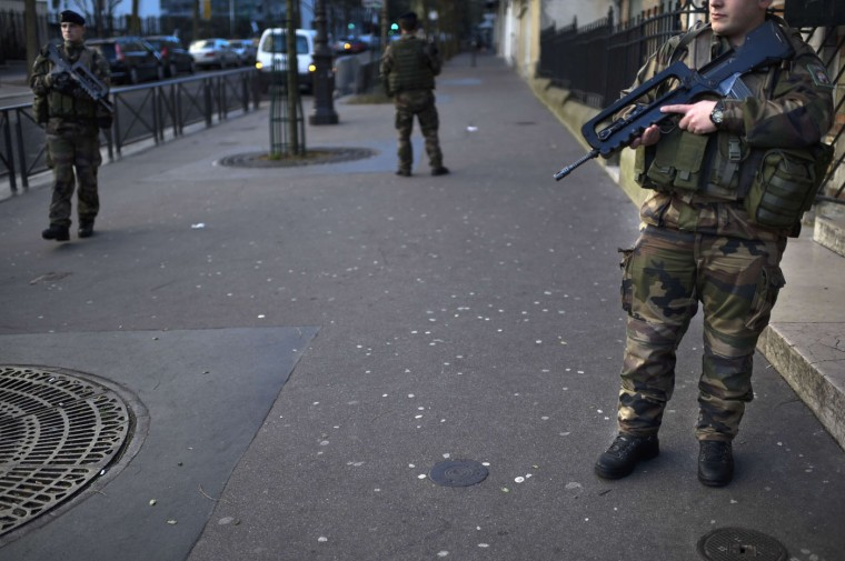 "French soldiers patrol on January 14, 2015 in Paris, after France announced an unprecedented deployment of thousands of troops and police to bolster security at ""sensitive"" sites following last week's jihadist attacks in Paris.The alert level in shell-shocked France remained at its highest possible as the interior minister announced the deployment of nearly 5,000 police to guard Jewish schools and places of worship. (Martin Bureau/AFP/Getty Images)"