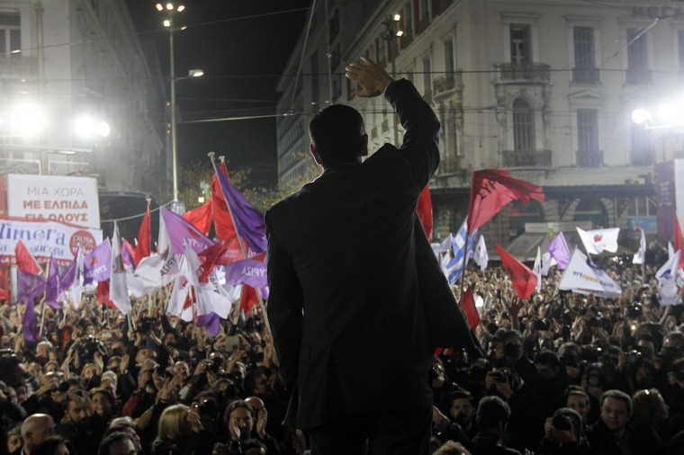 Head of the leftist Syriza party Alexis Tsipras waves to his supporters during a party election rally in central Athens on January 22, 2015, ahead of Greece's general election on January 25. Greeks vote on January 25 in a general election for the second time in three years, with radical leftists Syriza leading the polls with a promise to renegotiate the international bailout that has imposed five years of austerity on the country. (AFP/Getty Images/Orestis Panagiotou)