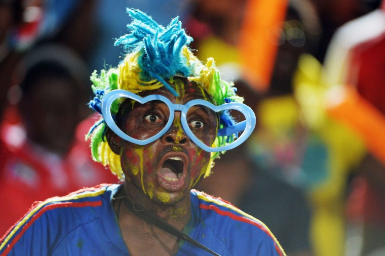 A Democratic Republic of the Congo fan cheers for his team during the 2015 African Cup of Nations group B football match between Cape Verde and Democratic Republic of the Congo in Ebebiyin on January 22, 2015. (AFP Photo/Khaled Desouki)