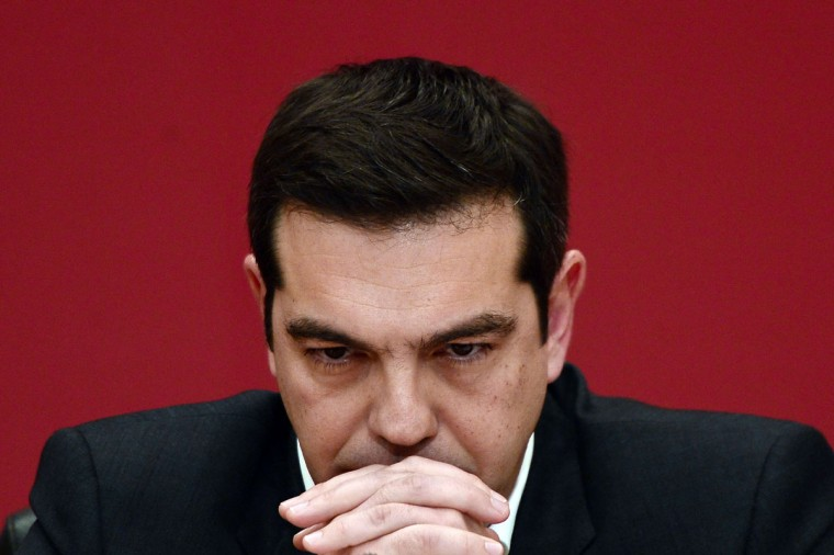 The leader of the leftist Syriza party, Alexis Tsipras, listens to a question during a televised press conference on January 23, 2015 at the Zappion Hall in Athens. Greeks vote on January 25 in a general election for the second time in three years, with radical leftists Syriza leading the polls with a promise to renegotiate the international bailout that has imposed five years of austerity on the country. (AFP Photo/Louisa Gouliamaki)