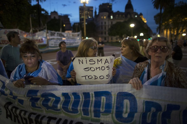 "A protester carries a sign that reads in Spanish ""We're all Nisman,"" referring to the death of special prosecutor Alberto Nisman, in Plaza de Mayo square in Buenos Aires, Argentina, Monday, Jan. 26, 2015. Nisman was found dead Jan. 18 in his apartment, the day before he was scheduled to elaborate on explosive allegations that President Cristina Fernandez shielded Iranian officials suspected in the largest terrorist attack in the South American country's history. (AP Photo/Ivan Fernandez)"