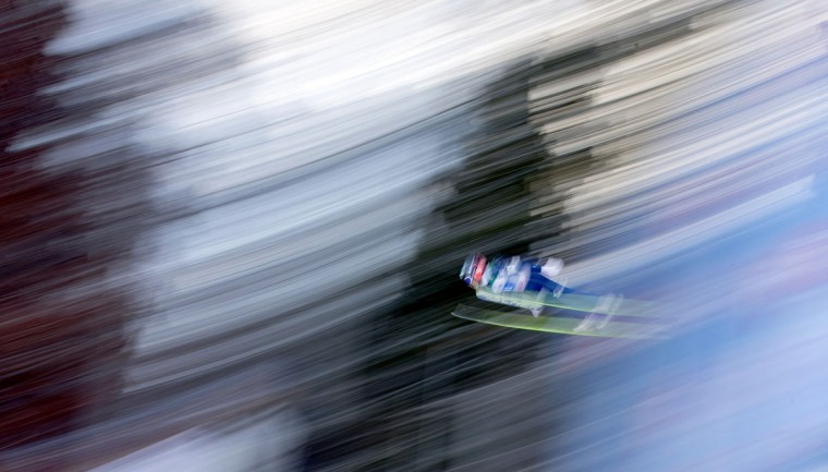 In this picture taken with a longtime exposure Japan's Reruhi Shimizu soars during the trial jump of the fourth stage of the four hills ski jumping tournament in Bischofshofen, Austria, on Tuesday, Jan. 6, 2015. (AP Photo/Matthias Schrader)