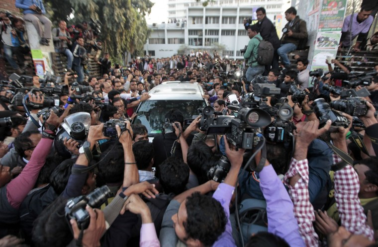 Journalists surround the car carrying Mirza Fakhrul Islam Alamgir, acting secretary general of the opposition Bangladesh Nationalist Party, after he was arrested reportedly for arson and vandalism, among other charges, from the National Press Club, in Dhaka, Bangladesh, Tuesday, Jan. 6, 2015. Clashes between police and opposition activists and a separate attack by unidentified gunmen left at least four people dead in Bangladesh on Monday amid heightened tensions on the anniversary of elections boycotted by the major opposition alliance last year. The Jan. 5 elections last year were boycotted by a major opposition alliance led by former Prime Minister Khaleda Zia. Tensions heated up recently after Prime Minister Sheikh Hasina's Awami League party said it would hold rallies to celebrate the anniversary, while Zia, her archrival, announced that anti-government protests would take place. (AP Photo/ A.M. Ahad)