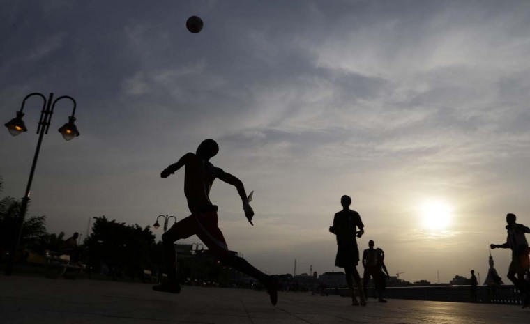 Young boys play street football along the coast in Bata, Equatorial Guinea, Thursday, Jan. 29, 2015. The city of Bata is hosting the African Cup of Nations tournament. (AP Photo/Themba Hadebe)