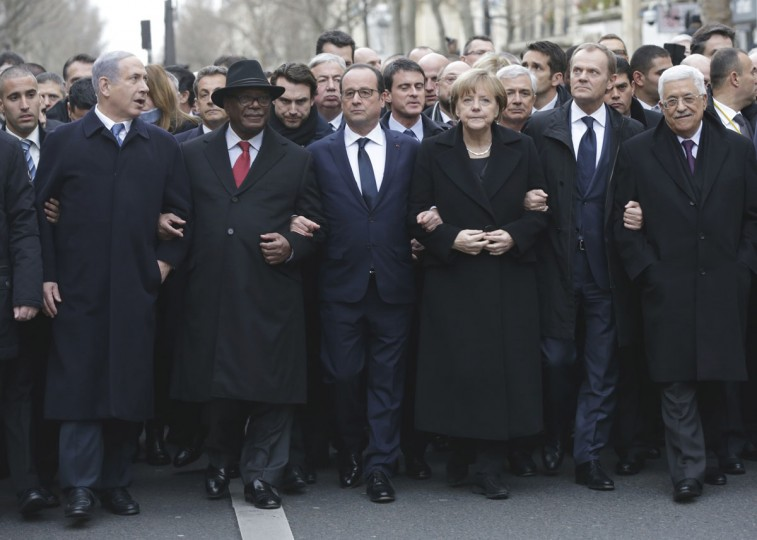 From the left, Israeli Prime Minister Benjamin Netanyahu, Malian President Ibrahim Boubacar Keita, French President Francois Hollande, German Chancellor Angela Merkel, EU president Donald Tusk and Palestinian Authority President Mahmoud Abbas march during a rally in Paris, France, Sunday, Jan. 11, 2015. A rally of defiance and sorrow, protected by an unparalleled level of security, on Sunday will honor the 17 victims of three days of bloodshed in Paris that left France on alert for more violence. (AP Photo/Philippe Wojazer, Pool)