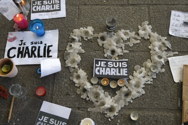 "A heart formed by melted candles is on the ground of the Old-Port to pay tribute to the victims of the satirical newspaper ""Charlie-Hebdo"", in Marseille, southern France, Thursday, Jan. 8, 2015, a day after masked gunmen stormed the offices of a satirical newspaper and killed 12 people. French police hunted Thursday for two heavily armed men ó one with a terrorism conviction and a history in jihadi networks ó in the methodical killing of 12 people at a satirical newspaper that caricatured the Prophet Muhammad. (AP Photo/Claude Paris)"