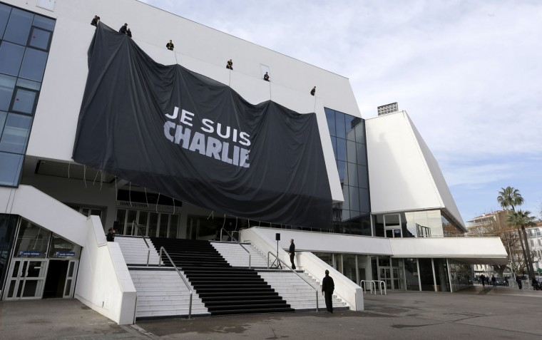 Workers install a giant banner reading ìI am Charlieî for victims of the shooting at the satirical newspaper Charlie Hebdo, on the Cannes Festival Palace, in Cannes, southeastern France, Friday, Jan. 9, 2015. 12 people were killed last Jan. 7 in a terrorist attack at the Charlie Hebdo headquarters in Paris. (AP Photo/Lionel Cironneau)